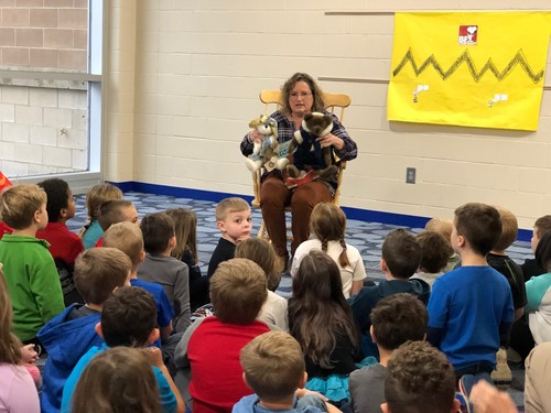 Superintendent Angela Smith reads to students
