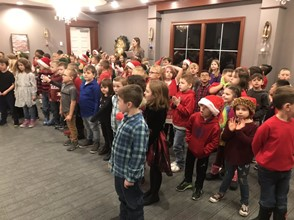 elementary students singing at nursing home